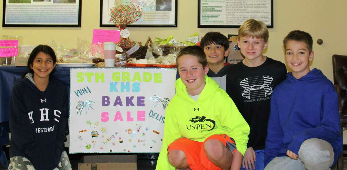 Kings Highway Elementary School students Samantha Henske, Charlie Leahey, Caden Wilson, Will Davitt, and Henry Grossberg raise money for their 5th grade graduation in Town Hall on election day Nov. 7.