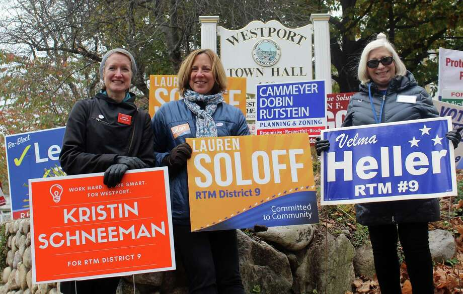District 9 Representative Town Meeting candidates Kristin Schneeman, Lauren Soloff and Velma Heller hold signs outside of the Westport Town Hall on election day Nov. 7. Photo: Sophie Vaughan /Hearst Connecticut Media