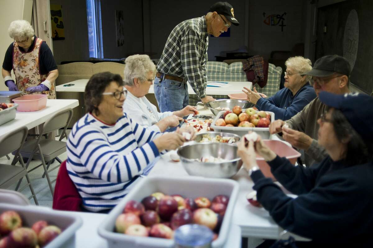 A group of volunteers works to make applesauce on Tuesday, Nov. 7, 2017 in preparation for Our Savior Lutheran Church's annual Sausage and Sauerkraut Supper, to be held this coming Tuesday, Nov. 14. (Katy Kildee/kkildee@mdn.net)