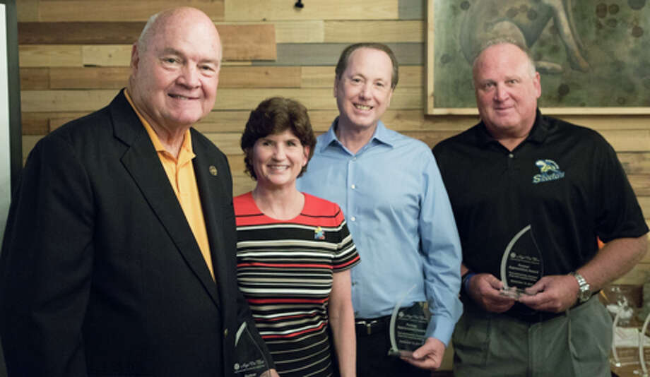 Hope For Three Executive Director Darla Farmer, honors, from left, Robert Hebert, Fort Bend County judge; Jim McClellan, president of the Fred & Mabel R. Parks Foundation, and Jay Miller, president, Sugar Land Skeeters, with Partner Appreciation Awards for their long-term support. Photo: Hope For Three