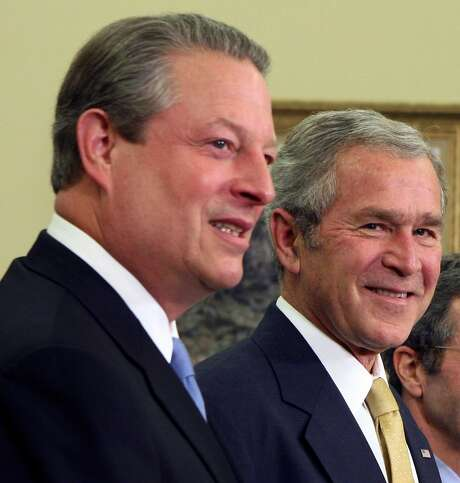 Al Gore and George W. Bush put aside their differences after their bitter election for the good of the country. Photo: DOUG MILLS, NYT