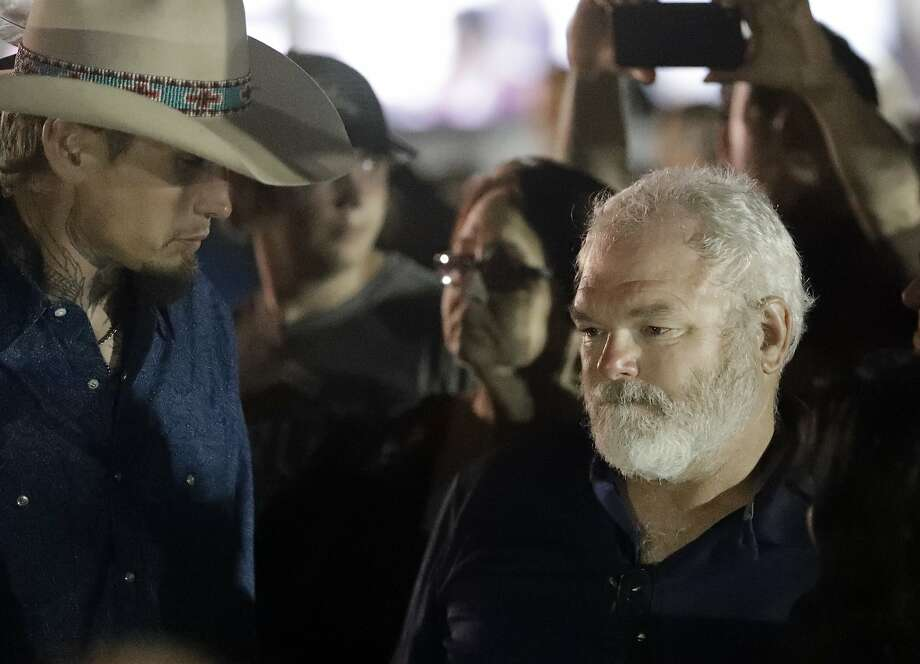 Stephen Willeford, right and Johnnie Langendorff, left, attend a vigil for the victims of the First Baptist Church shooting Monday, Nov. 6, 2017, in Sutherland Springs, Texas. Willeford shot suspect Devin Patrick Kelley, and Langendorff drove the truck while chasing Kelley. Kelley had opened fire inside the church in the small South Texas community on Sunday, killing more than two dozen and injuring others. (AP Photo/David J. Phillip) Photo: David J. Phillip, Associated Press
