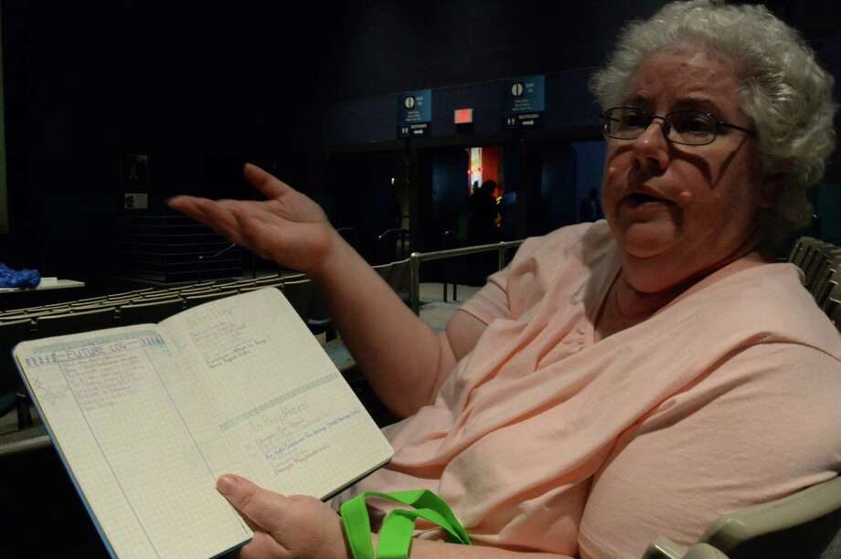Jennifer Hebert has written all of her experiences during and since Hurricane Harvey in tiny type in a notebook, including how flooding forced her from her home and how she and her dog had to wait overnight in the parking lot of the George R. Brown Convention Center before getting inside.