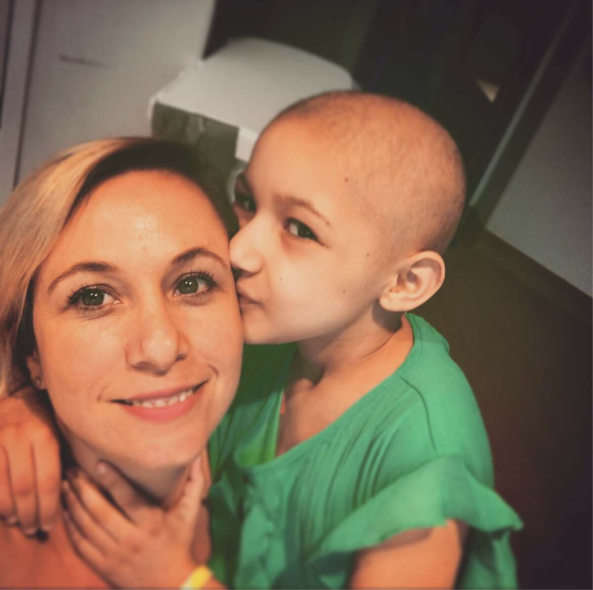 Susana Obregon, 7, and her mother - also named Susana - share a tender moment. The younger Susana suffers from Acute Lymphoblastic Leukemia but is receiving treatment atTexas Children's Hospital in Houston.