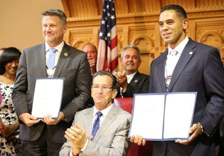 Gov. Dannel Malloy, center, signs tribal amendments Photo: CTNewsJunkie File Photo / CTNewsJunkie File Photo