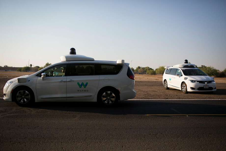 FILE- Waymo's driverless cars at a media event in Chandler, Ariz., June 28, 2017. The company, a unit of Alphabet, Google's parent, is believed to be the first to test such cars on public roads without backup drivers. (Caitlin O'Hara for The New York Times) Photo: CAITLIN O'HARA, NYT