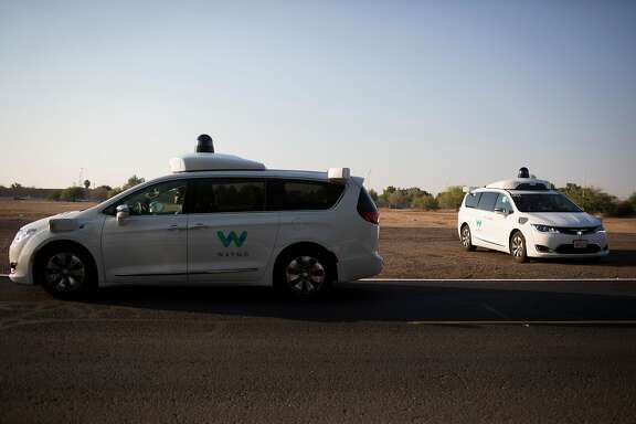 FILE- Waymo�s driverless cars at a media event in Chandler, Ariz., June 28, 2017. The company, a unit of Alphabet, Google�s parent, is believed to be the first to test such cars on public roads without backup drivers. (Caitlin O'Hara for The New York Times)
