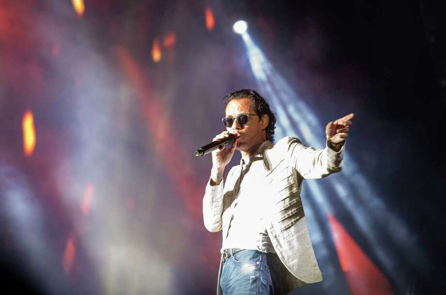 "Puerto Rican singer Marc Anthony performs during the Festival ""Presidente"" at the Estadio Olimpico in Santo Domingo, Dominican Republic, on 03 November 2017.  / AFP PHOTO / Erika SANTELICESERIKA SANTELICES/AFP/Getty Images Photo: ERIKA SANTELICES, Contributor / afp"