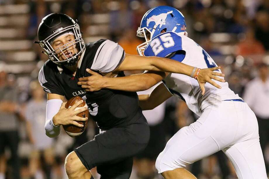 Clark's Jayson Flores tries to escape fom Jay's Leo Gonzalez during the second half of their District 28-6A Zone B high school football game at Gustafson Stadium on Friday, Oct. 13, 2017. Jay held on to beat Clark 47-46. Photo: Marvin Pfeiffer /Express-News