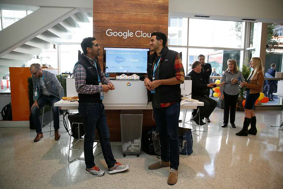 Prajesh Parekh (left) and Gabriel Jimenez (right) from Google Cloud in the lobby of the Museum of the African Diaspora. Salesforce and Google announced a partnership at Dreamforce Monday. Photo: Liz Hafalia, The Chronicle
