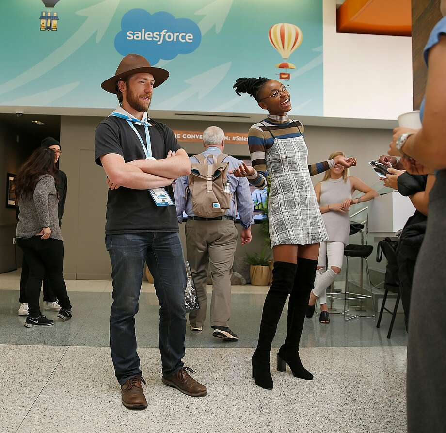 Photo booth ranger Christopher Rupley (left) and comedian Fredia (right) from WeWork entertain visitors. Photo: Liz Hafalia, The Chronicle