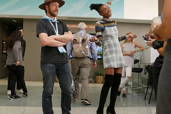 Photo booth ranger Christopher Rupley (left) and comedian Fredia (right) for Wework in the lobby of the The Museum of African Diaspora  during it's transformation for Salesforce during the Dreamforce conference on Tuesday, November 7, 2017, in San Francisco, Calif.