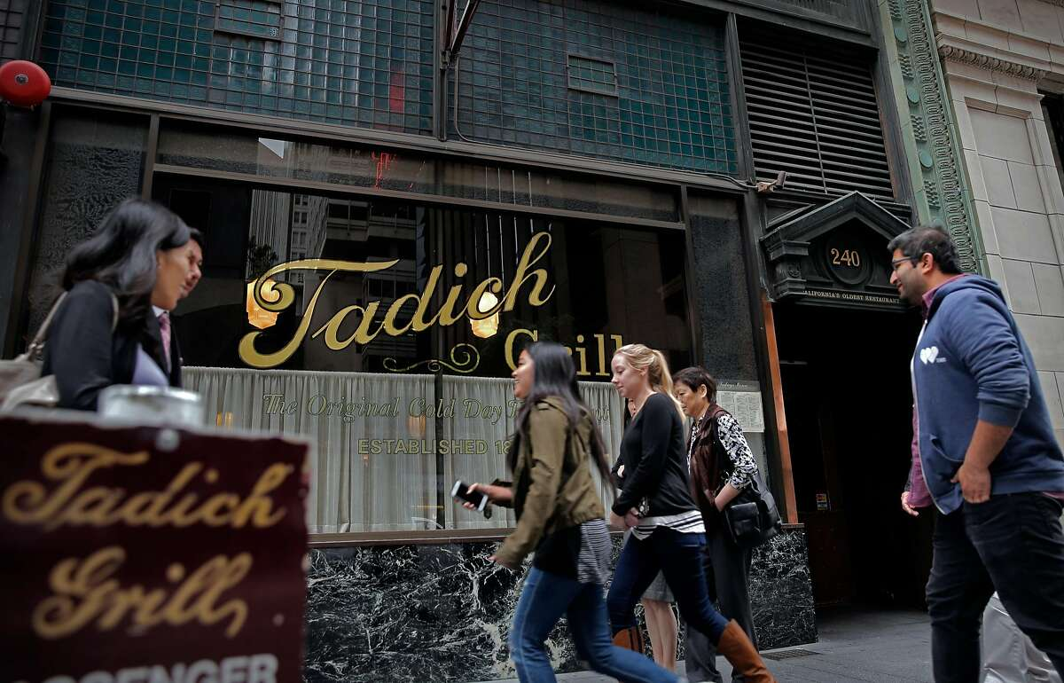 People passing by the Tadich Grill on California St. in San Francisco, Calif. on Tues. October 27, 2015.