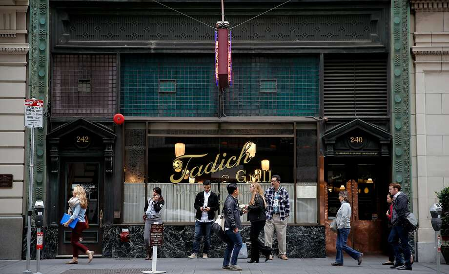 People passing by Tadich Grill on California St. in San Francisco, Calif. on October 27, 2015. Photo: Michael Macor, The Chronicle