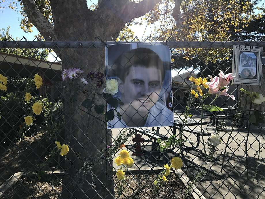 A makeshift memorial for 17-year-old Lawrence Janson was set up Tuesday, Nov. 7, 2017, outside Olympic Continuation High School in Concord, where he was a student. The teenager was shot to death Monday about a block from the school. Photo: Sarah Ravani