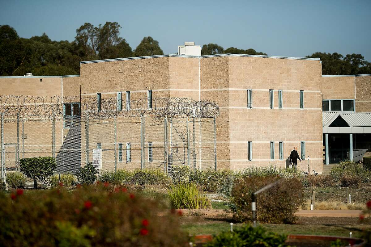 A chaplain passes a building at the West County Detention Facility in Richmond.