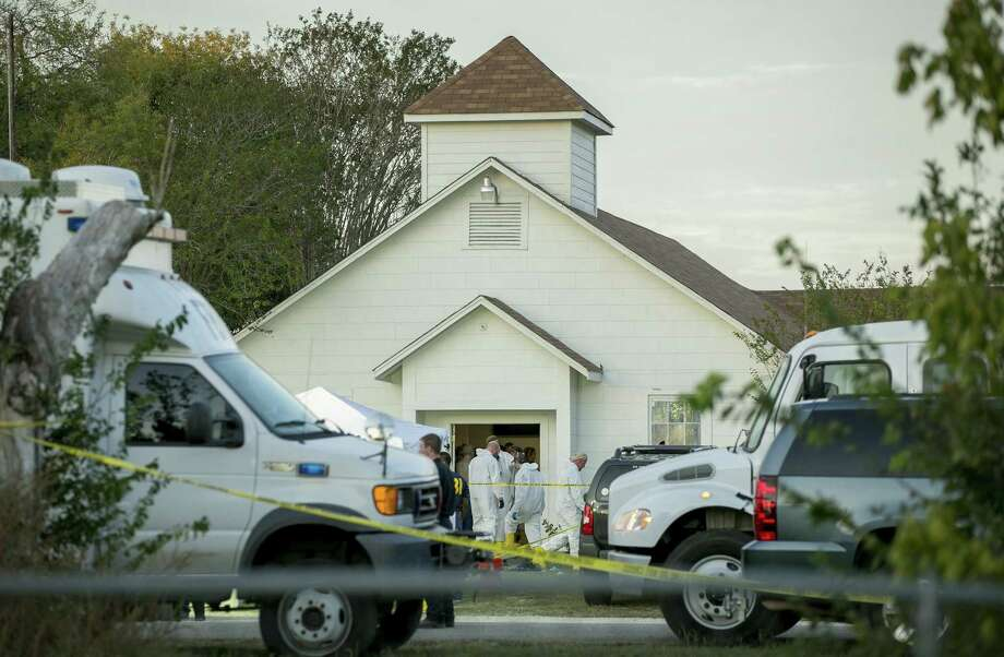 Investigators work at the scene of a mass shooting at the First Baptist Church in Sutherland Springs, Texas on Sunday. Should Devin Kelley have been allowed to buy guns? Photo: Jay Janner /TNS / Austin American-Statesman
