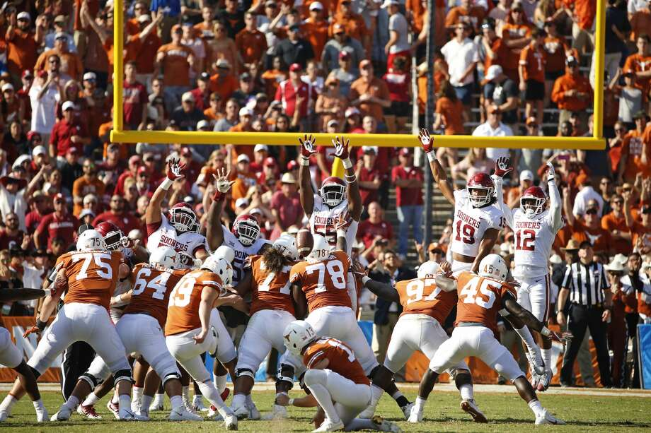 Texas place kicker Joshua Rowland (49) kicks a field goal against Oklahoma to end the first half of an NCAA college football game, Saturday, Oct. 14, 2017, in Dallas, Texas. (AP Photo/Ron Jenkins)