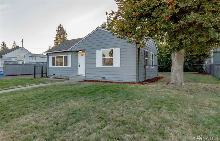 This quaint home has undergone an indoor remodel without losing its character. This two-bedroom charmer has new windows, a totally redone open kitchen, and new flooring, lights, doors, and bathroom.9903 34th Ave. S.W., listed for $469,000. See the full listing below. Photo: Imaging Northwest