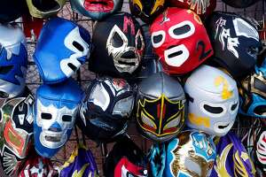 Lucha Libre masks at Mixcoatl Arts and Gifts on 24th Street in the Calle 24 Latino Cultural District in San Francisco, Calif., on Sunday, October 22, 2017.