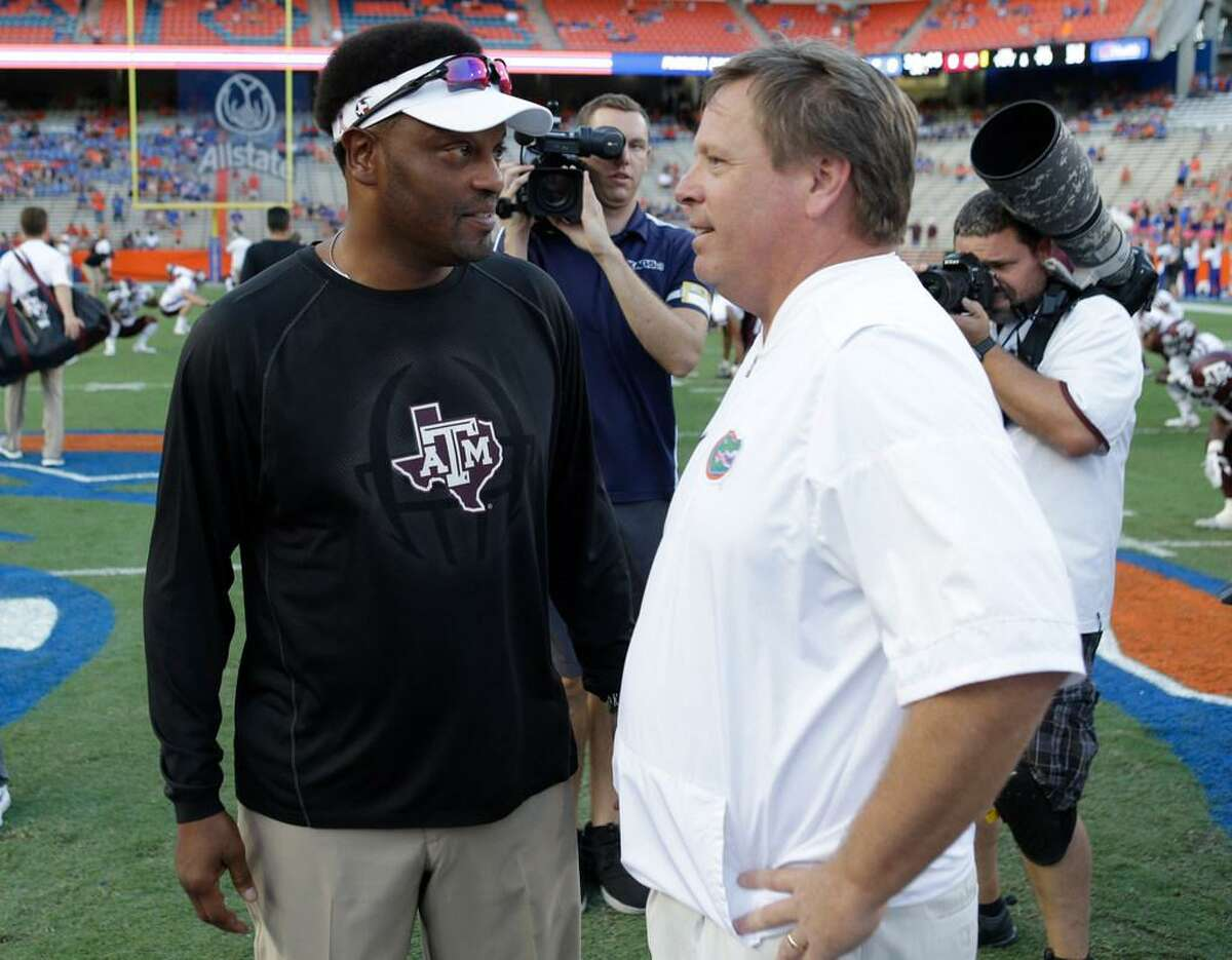 Texas A&M head coach Kevin Sumlin, left, and Florida head coach Jim McElwain meet at midfield before their Oct. 14, 2017 game in Gainesville, Fla.