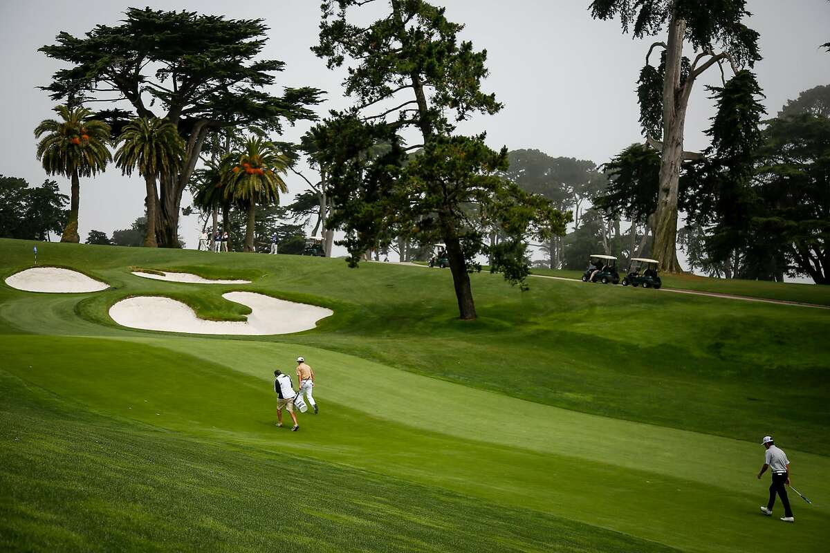 Noah Norton walks with his caddy during the 106th California Amateur Championship at the Olympic Club in San Francisco on Saturday, June 24, 2017.