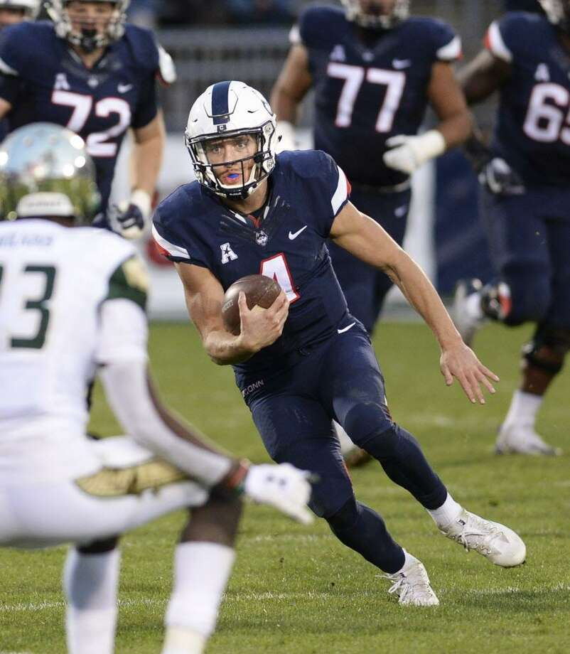 UConn quarterback Bryant Shirreffs gains some yardage on a keeper in the second half of Saturday's game against South Florida. Photo: Stephen Dunn / Associated Press / FR171426 AP