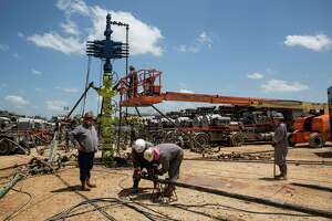 People work on the Abraxas Petroleum Corporation frac spread in Atascosa County Texas on August 23, 2016.