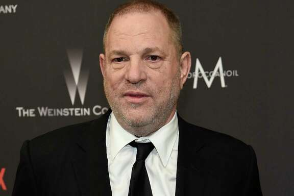FILE - In this Jan. 8, 2017, file photo, Harvey Weinstein arrives at The Weinstein Company and Netflix Golden Globes afterparty in Beverly Hills, Calif. The New York Times says it's inexcusable that lawyer David Boies' firm tried to halt the newspaper's investigation into sexual harassment charges against Hollywood mogul Harvey Weinstein while it was also working on other matters for the Times. (Photo by Chris Pizzello/Invision/AP, File)