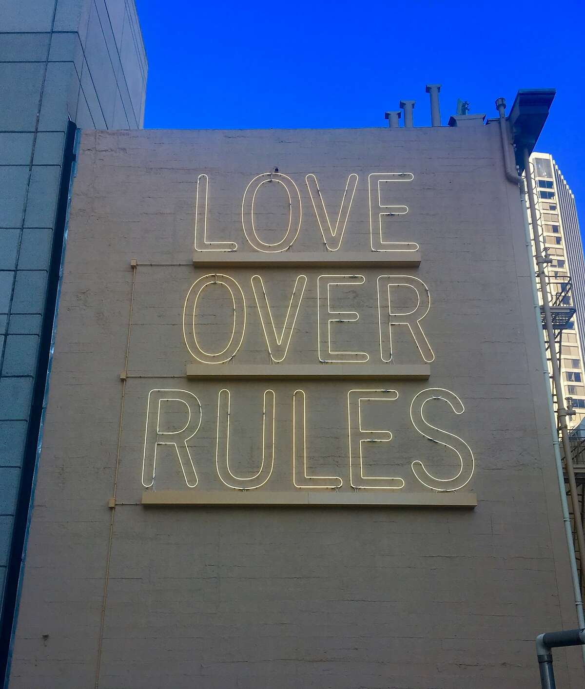 """""""LOVE OVER RULES,"""" a permanent work by Hank Willis Thomas, as seen from Annie St. in San Francisco"""