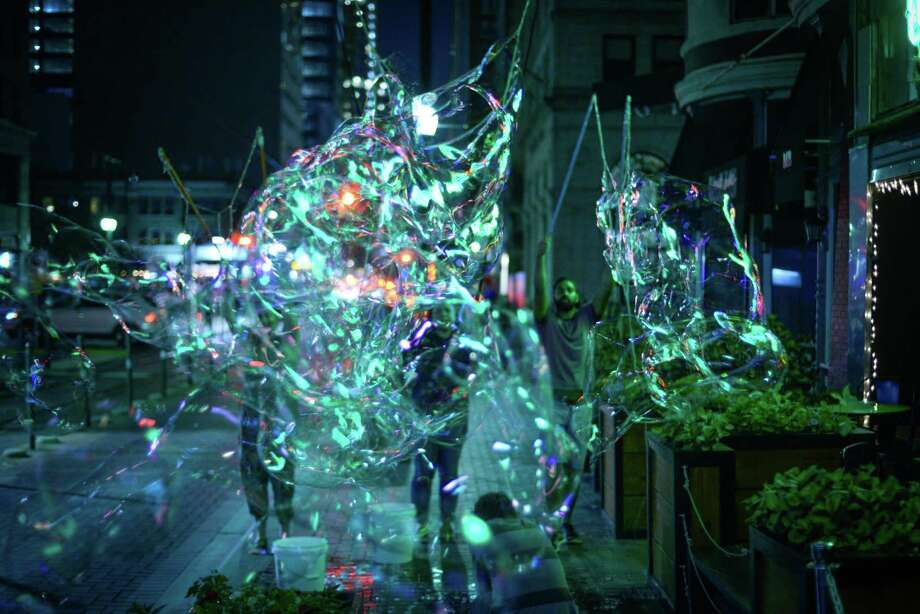 "The collaborative CRITT Project will perform ""Burst,"" a piece involving dance and massive bubbles, on a grassy slope near Market Street as part of the 2017 edition of Luminaria. Photo: Courtesy Photo"