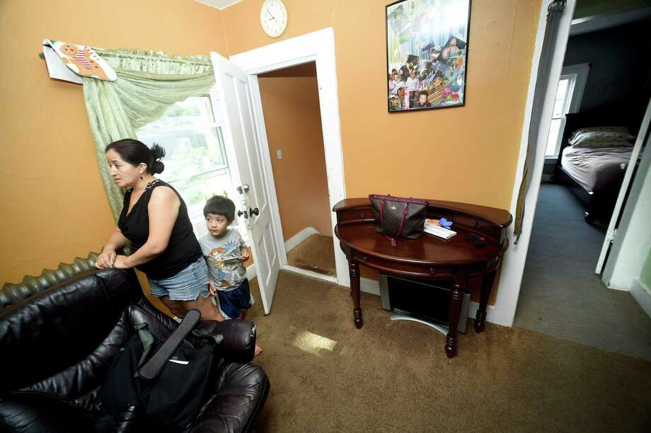 Gloria Montero and her son, Jacob Guaman, 5, in their apartment on Whalley Avenue in New Haven in 2017. Photo: Arnold Gold / Hearst Connecticut Media / New Haven Register