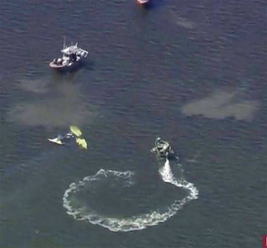 In this image provided by WTVT-TV FOX 13 Tampa Bay, authorities investigate a small plane crash in the Gulf of Mexico, near Holiday, Fla. on Tuesday, Nov. 7, 2017. Authorities have confirmed that former Major League Baseball pitcher Roy Halladay died in a small plane crash in the Gulf of Mexico off the coast of Florida. (WTVT-TV FOX 13 Tampa Bay, via AP) Photo: Associated Press / WTVT-TV FOX 13 Tampa Bay,