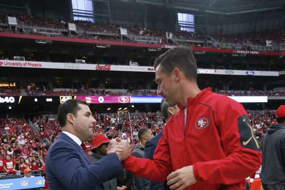 PHOENIX, AZ - OCTOBER 1: CEO Jed York and Head Coach Kyle Shanahan of the San Francisco 49ers talk on the sideline prior to the game against the Arizona Cardinals at the University of Phoenix Stadium on October 1, 2017 in Phoenix, Arizona. The Cardinals defeated the 49ers 18-15. (Photo by Michael Zagaris/San Francisco 49ers/Getty Images)