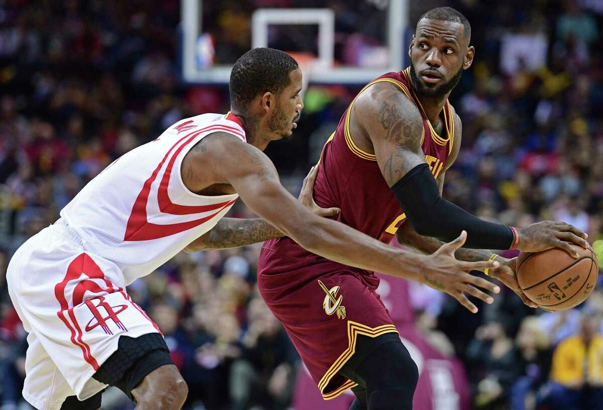 Rockets forward Trevor Ariza, left, will be one of several players called on to defend the Cavs' LeBron James, right.
