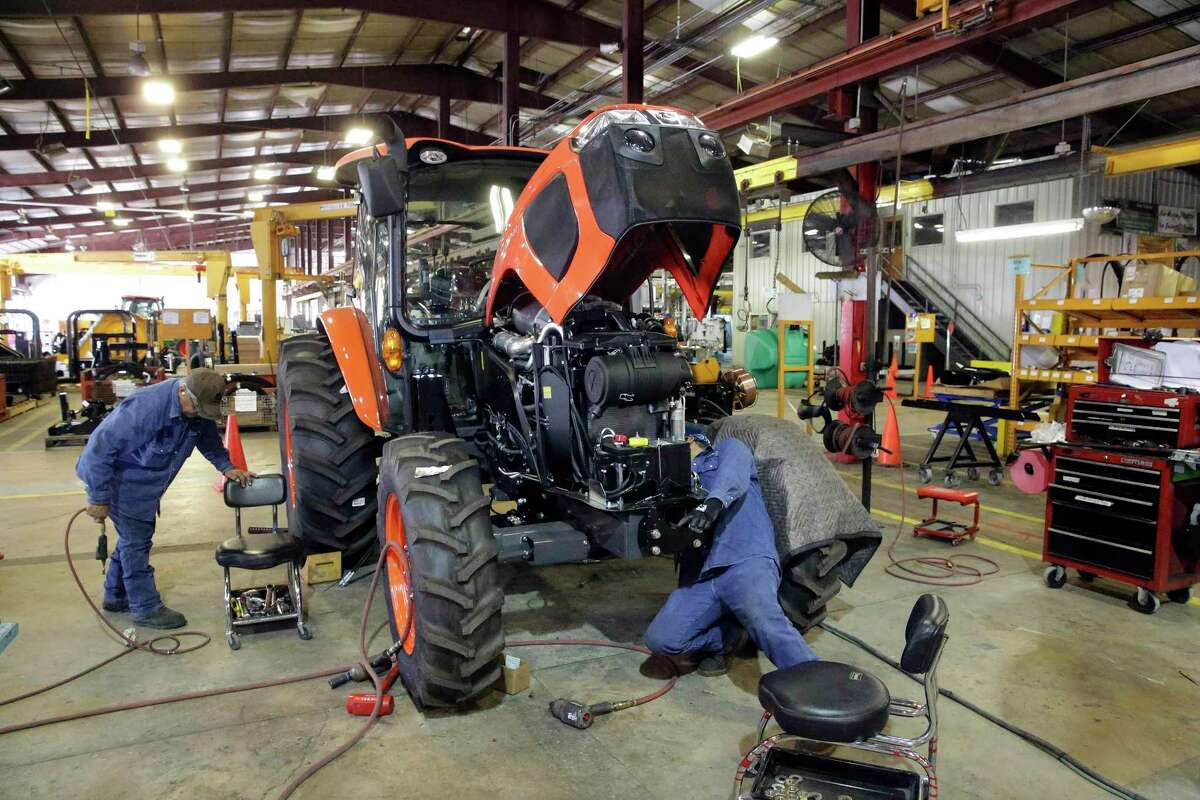 Kubota tractors are modified at the Alamo Group Manufacturing facility on August 22, 2017.