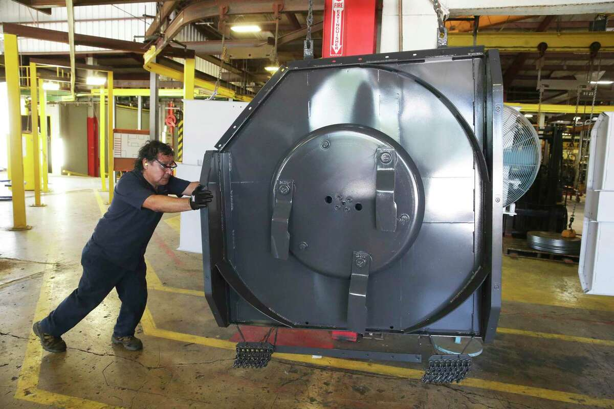 The blades and cowling for a mower are moved into another area at the Alamo Group Manufacturing facility on August 22, 2017.