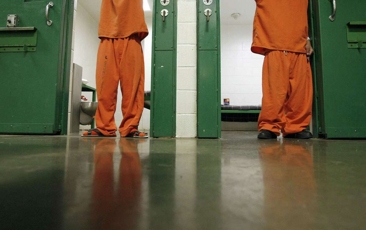 """Two 16 and under juveniles who have been charged as adults stand in their cells at the Harris County Jail on 1200 Baker St. Friday, May 11, 2012, in Houston. A new law states """"certified"""" juveniles, if housed in county jail, can't be housed within """"sight or sound"""" of adult prisoners. """"It is impossible for us to abide by these rules,"""" Harris County Sheriff spokesperson Christina Garza said. Due to the way the facility is set up, juvenile inmates will at some point, though kept separate, come with in sight or sound of an adult inmate while on their way to court, recreation time or to see a visitor. ( Johnny Hanson / Houston Chronicle )"""