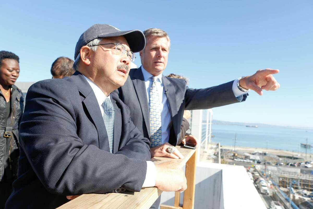 Rick Welts (right), president and COO of Warriors, and Mayor Ed Lee look over the active construction site during a sneak peak tour of the new Warriors arena construction site on Wednesday, November 7, 2017 in San Francisco, Calif.