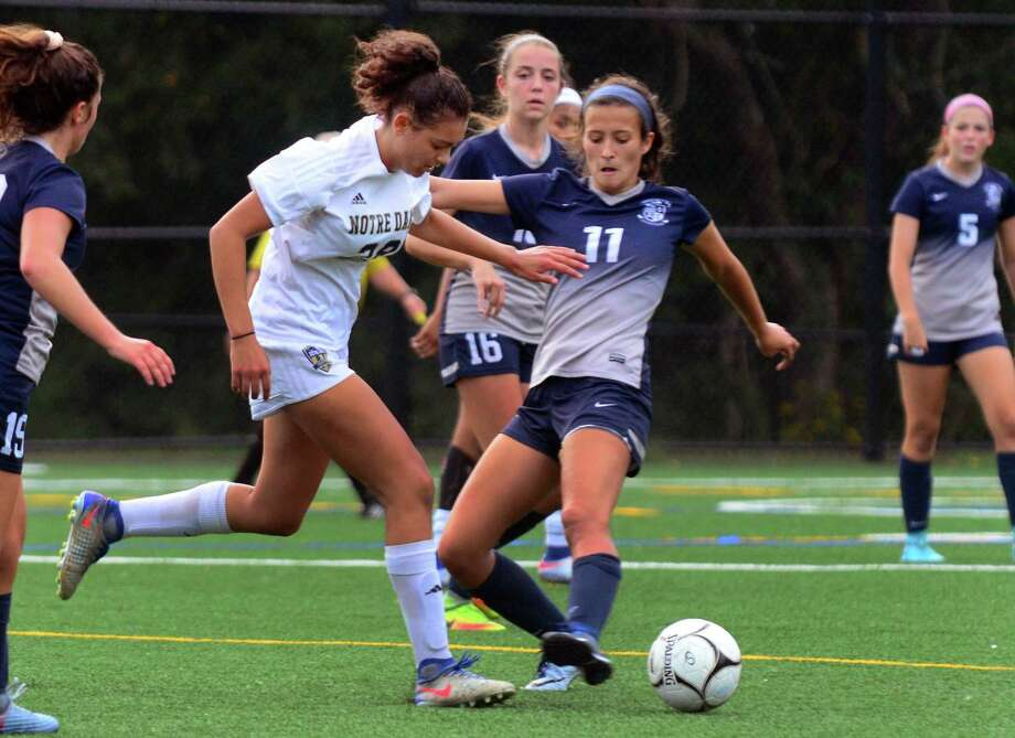 Immaculate's Kayla Mingachos (11) is part of a successful soccer family. Photo: Christian Abraham / Hearst Connecticut Media / Connecticut Post