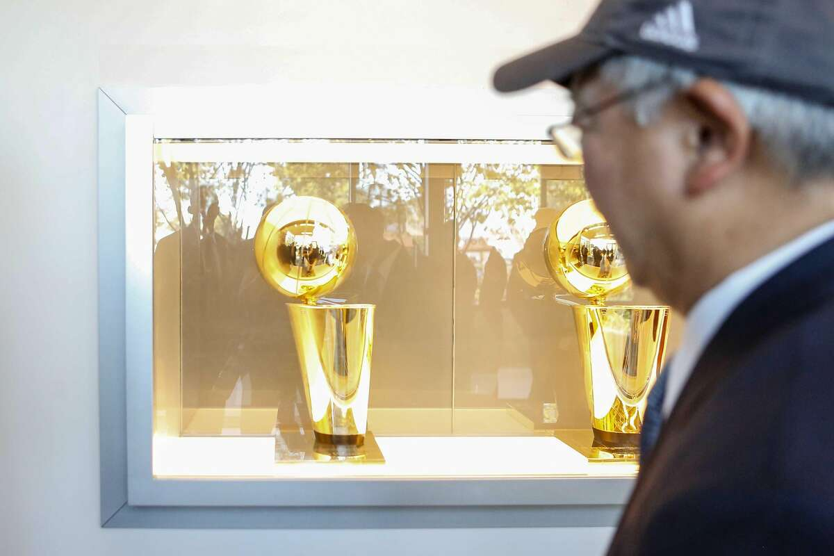 Mayor Ed Lee walks past the Warriors championship trophies during a sneak peak tour of the construction site at Chase Center on Wednesday, November 7, 2017 in San Francisco, Calif.