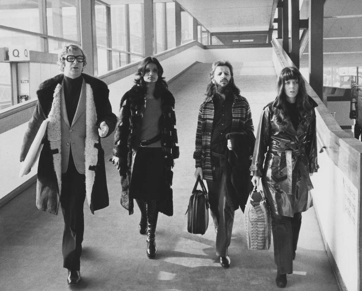 1) Michael Caine, his future wife Shakira Baksh, Ringo Starr, and his wife Maureen at London's Heathrow Airport in 1972. The four are departing for Budapest, where they will be guests at 40th birthday celebrations for actress Elizabeth Taylor.