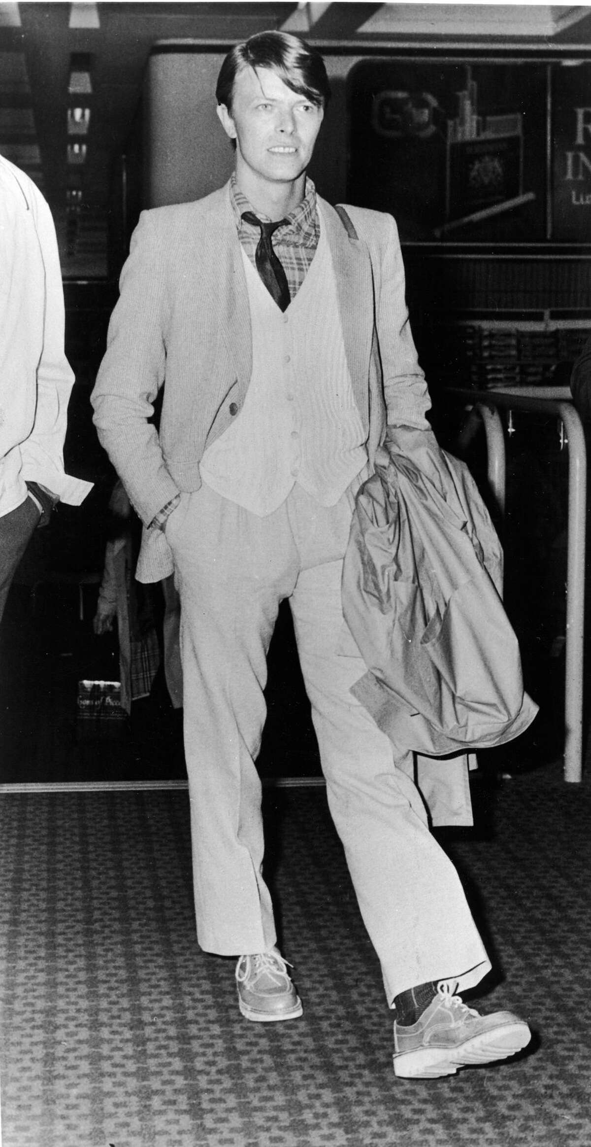 3) David Bowie at Heathrow Airport in 1978.