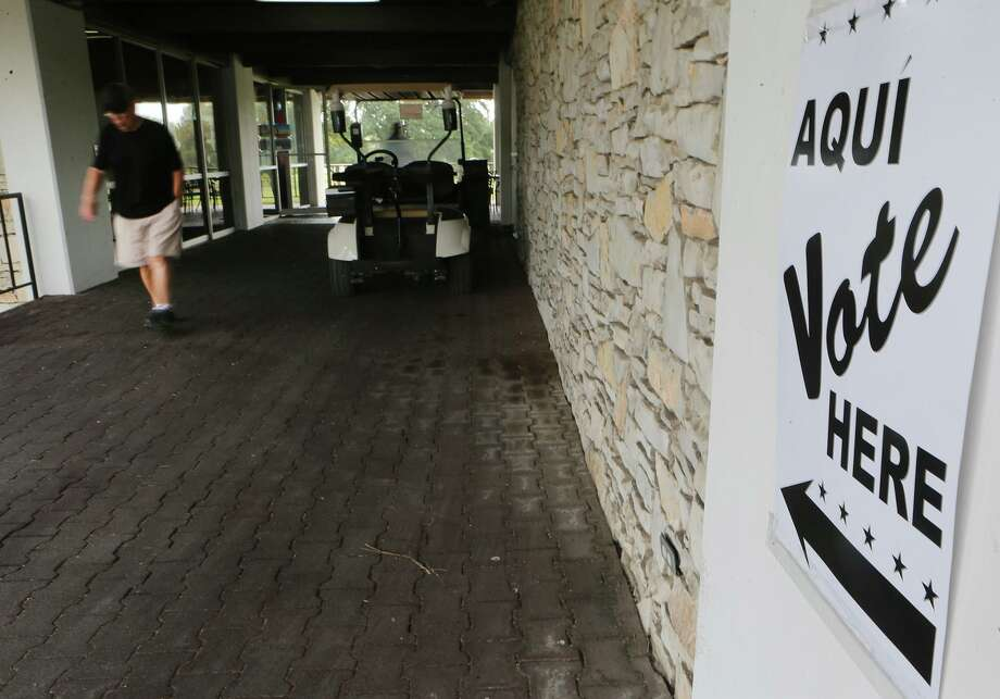A man leaves a polling site at the Olmos Basin Golf Course in San Antonio where voting was taking place Tuesday. Photo: John Davenport /San Antonio Express-News / ©John Davenport/San Antonio Express-News