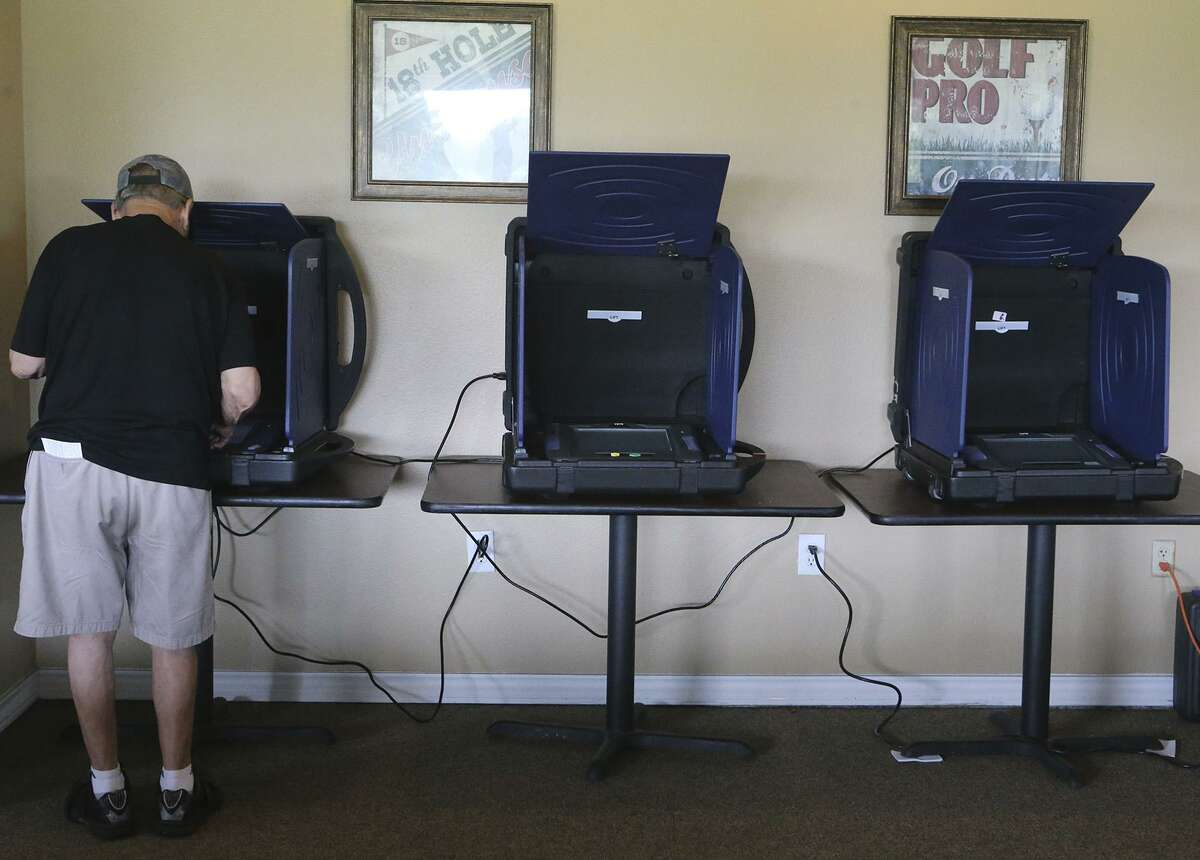 A man votes Tuesday November 7, 2017 at the Olmos Basin Golf Course in San Antonio. Voter turnout reached its lowest point in at least 23 years, Bexar County officials said.
