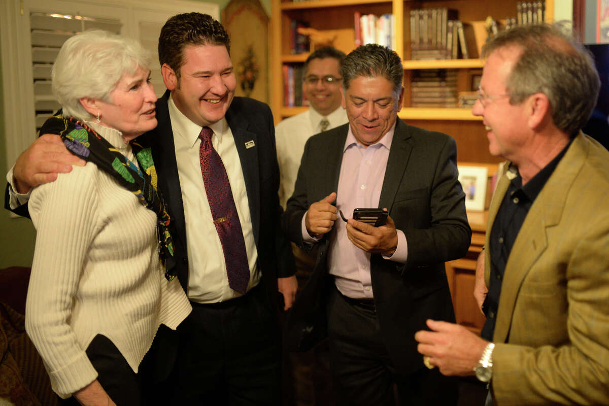 From left, city councilwoman Sharla Hotchkiss, city councilman J. Ross Lacy, city mayor Jerry Morales, and Midland Development Corporation president Brent Hilliard react to early voting results in favor of the proposed Road Bond Nov. 7, 2017, at an election results party. James Durbin/Reporter-Telegram