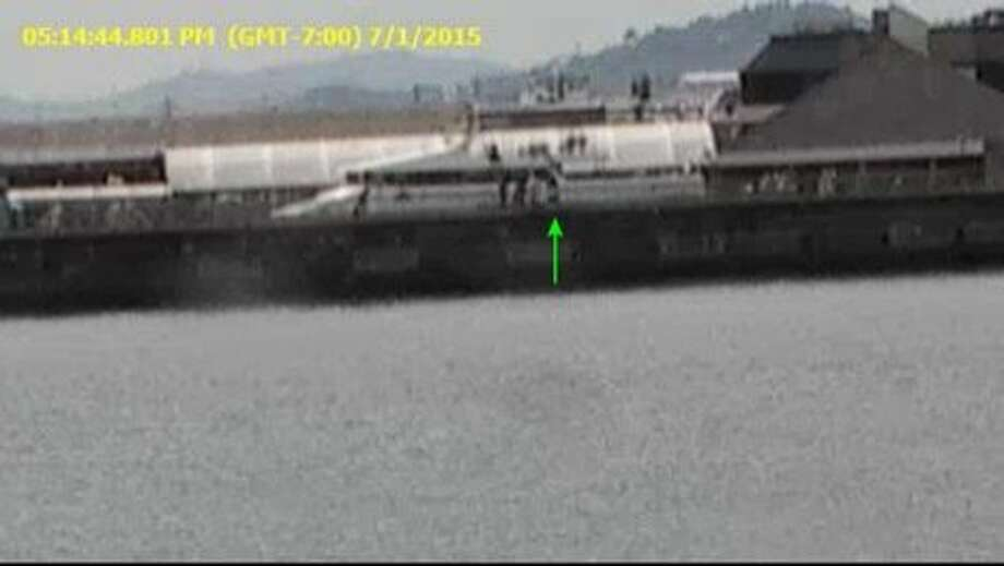 Surveillance footage of San Francisco's Pier 14 show six individuals gathered around the seat where 45-year-old Jose Ines Garcia Zarate sat when he allegedly shot and killed Kate Steinle on July 1, 2015. His attorneys presented this footage in court on Tuesday, Nov. 7, 2017 in support of their claim that Garcia Zarate accidentally discharged the weapon shortly after he found it under his seat on the pier. They said the surveillance footage showed that those six individuals had possibly discarded the gun there. Photo: Courtesy, San Francisco Public Defender's Office