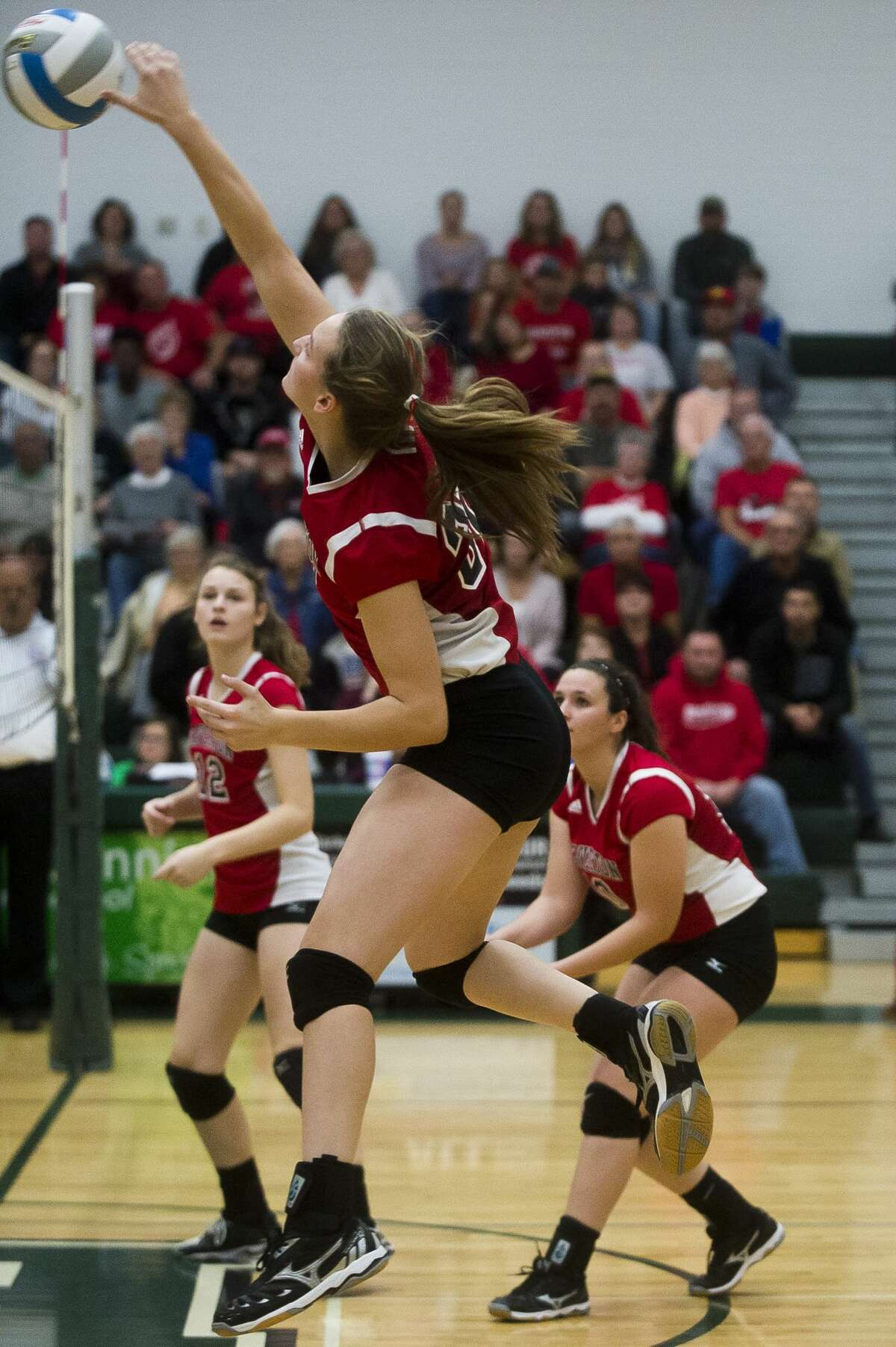 Beaverton freshman Molly Gerow spikes the ball during Beaverton's regional final against Ravenna on Tuesday, Nov. 7, 2017 at Pinconning High School. (Katy Kildee/kkildee@mdn.net)