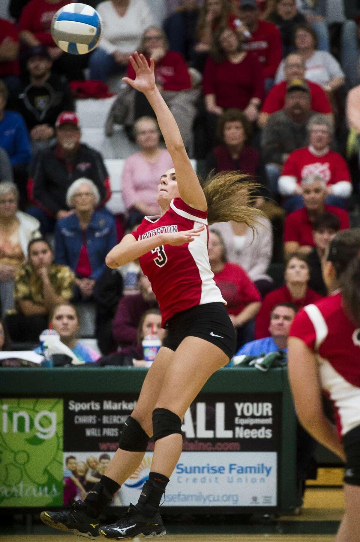 Beaverton senior Reiss Faber spikes the ball during Beaverton's regional final against Ravenna on Tuesday, Nov. 7, 2017 at Pinconning High School. (Katy Kildee/kkildee@mdn.net)