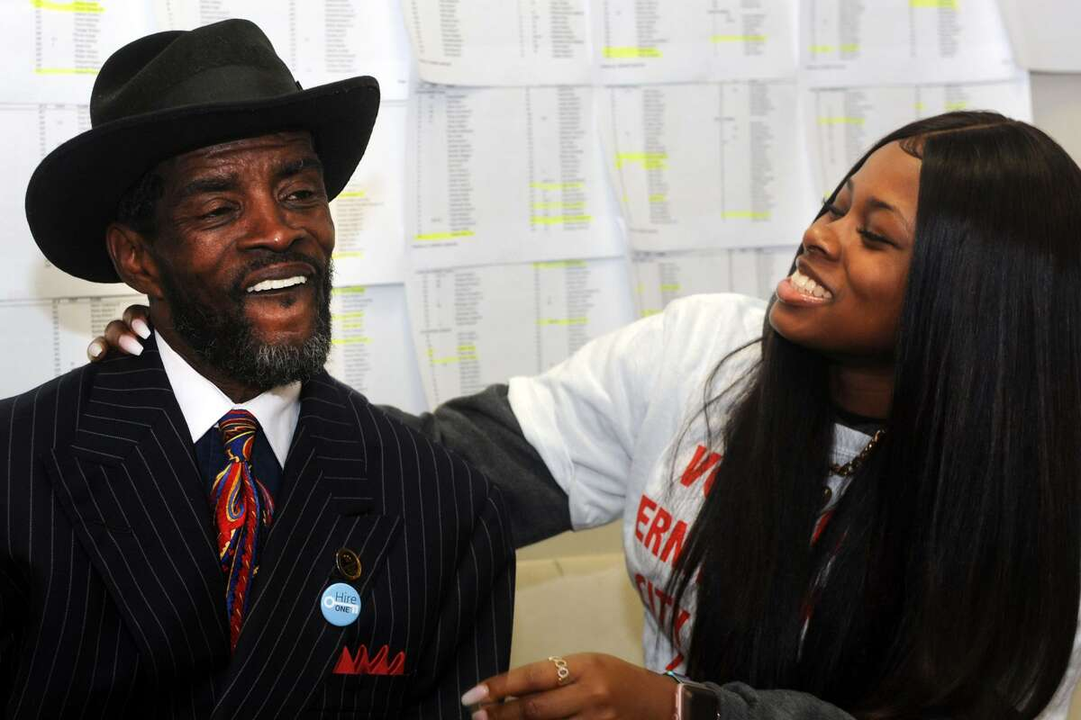 Ernest Newton, candidate in Bridgeport's 139th City Council District, celebrates with his daughter, Kayla, as election results come in at his campaign headquarters in Bridgeport, Conn. Nov. 7, 2017. Newton secured a seat on the city council in Tuesdays elections.